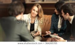 190731102530group_successful_businessmen_discussion_important_450w_364265705.jpg